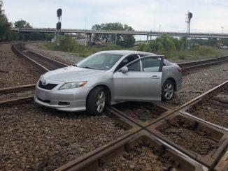 woman unharmed car railroad tracks