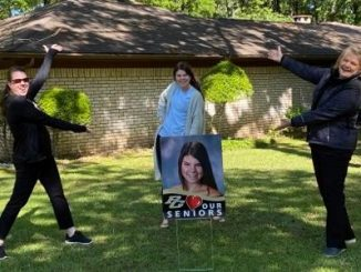 """Pleasant Grove High School delivers """"We Love Our Seniors"""" Signs to students"""